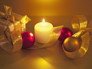 Christmas ornaments with ribbon and candle