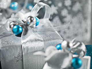 Christmas gifts with silver ribbon and wrapping