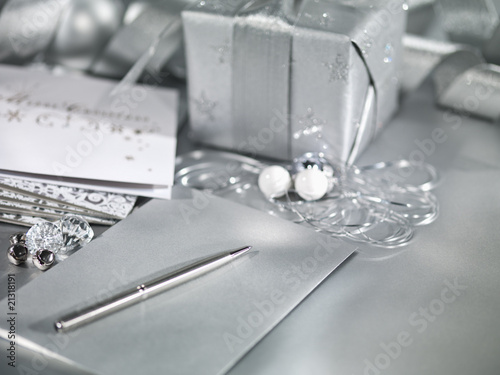 """Christmas gifts with silver ribbon, wrapping and card"""