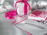 """Christmas gifts with ribbon, pen and card"""