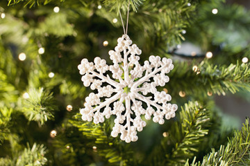 Snowflake Christmas ornament on tree