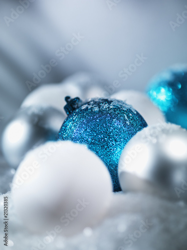 Pile of Christmas ornaments in snow
