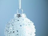 White Christmas ornament hanging on string