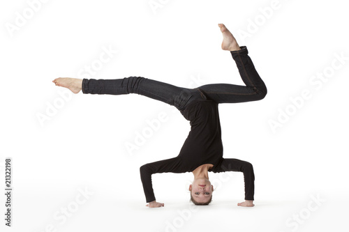 Teenage girl in headstand