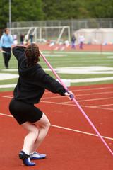 Female athlete throwing javelin.