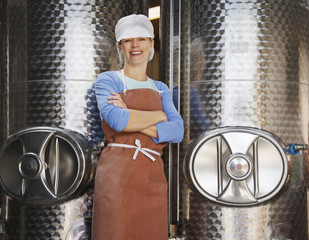 Woman posing in front of vats