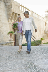 Man and woman holding hands and walking