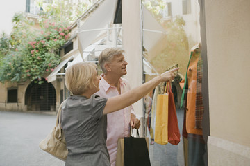 Man and woman window shopping