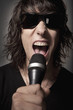 Man with sunglasses singing