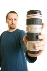 man holding a camera lens
