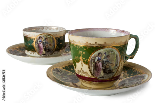 two antique teacups on a white background