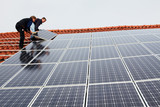 installing solar modules on a roof 04 poster
