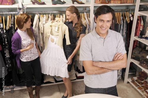 Shop assistant and shoppers