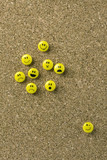 Group of expressive yellow faced thumb tacks