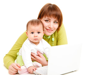 Mom and baby working at netbook