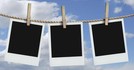 three polaroids hanging with blue sky
