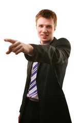 A young business man, pointing index finger.