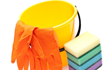 Yellow bucket, gloves and sponges