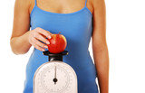 Weight obsessed woman weighing apple poster