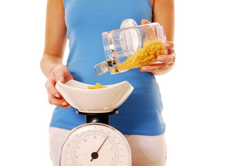 Weighing pasta on kitchen scales