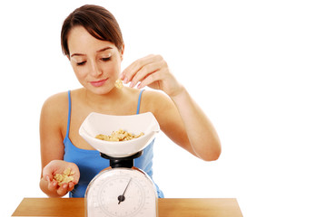 Woman weighing cereal on scales
