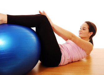 Woman using exercise ball for fitness