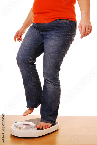 Woman standing on bathroom scales