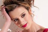 Close-up of beautiful girl with red vogue maekeup poster