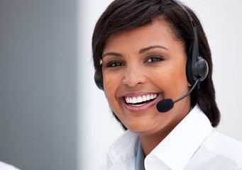 Portrait of an ethnic customer service agent at work