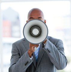 Ethnic businessman yelling through a megaphone