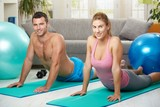 Couple streching abdominal poster