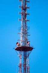 telecommunications tower over blue sky