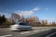 Speeding concept - Cars moving fast on a highway on a lovely a