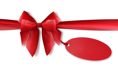 Red bow with blank tag isolated on white background