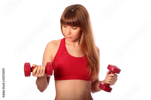 Young beautiful girl doing fitness exercises.