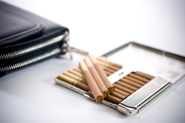 cigarettes in cigarette case and pochette