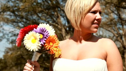 Lovely bride holding a colorful bouquet of flowers.