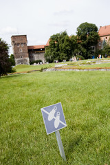 No Walking sign on Lawn in Wawel Castle.