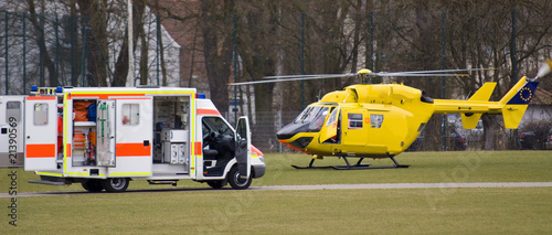A Rescue team with helicopter and ambulance