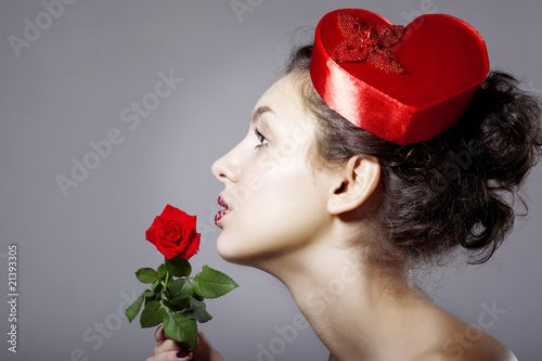 Glamorous girl in an elegant hat in the form of heart