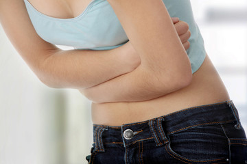 Teen woman with stomach ache