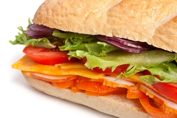 long baguette sandwich with lettuce, slices of fresh vegetables,