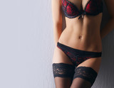 Young and sexy woman in erotic lingerie poster