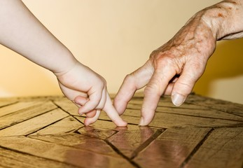 hand of grandmother and grandchild by the play