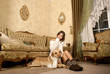 Attractive woman sitting with a dog