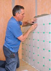 Man installing ceramic tile