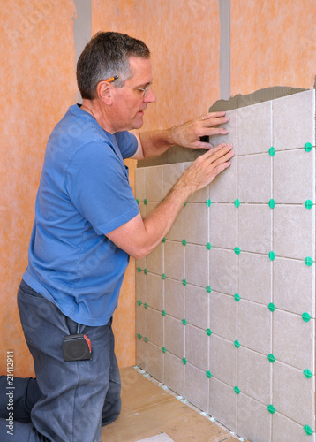 Man installing ceramic tile