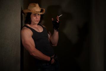 Smoking man in cowboy hat