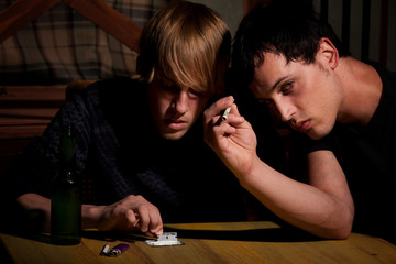 Two young men with heroin or cocaine