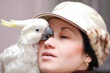 Girl with kissing parrot